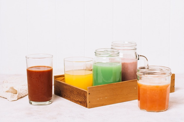 Front view arrangement of colorful smoothies