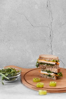 Front view arrangement of delicious sandwiches with copy space