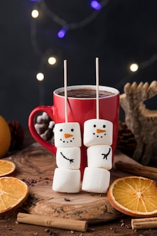 Front view arrangement with delicious christmas cup of hot chocolate