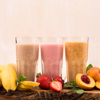 Front view of assortment of milkshakes with banana and strawberry