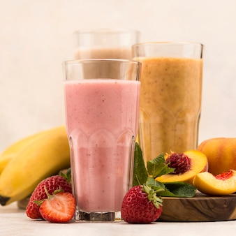 Front view of assortment of milkshakes with peach and banana