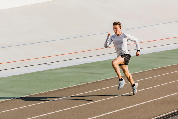 Front view of athlete running with copy space