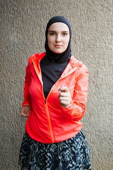 Front view of athlete with red jacket