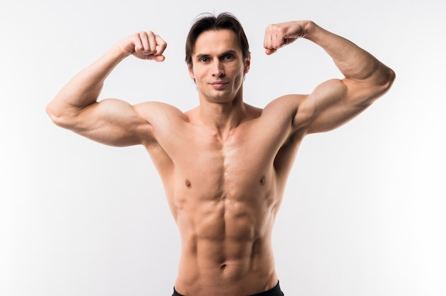 Front view of athletic man showing off biceps