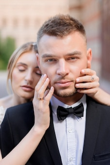 Front view of attractive newlyweds looking at the camera