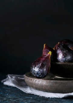 Front view of autumn figs on plate with copy space