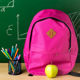 Front view of backpack for back to school with apple and pencils