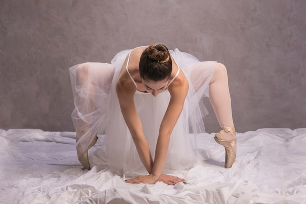 Front view ballerina bending over
