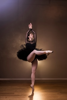 Front view ballerina dancing happily