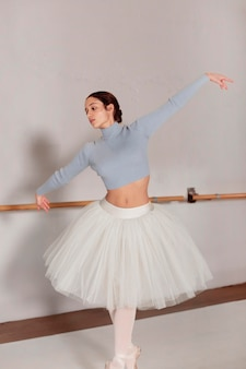 Front view of ballerina dancing  in tutu skirt