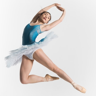 Front view of ballerina dancing in a tutu