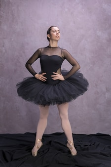 Front view ballerina posing confidently