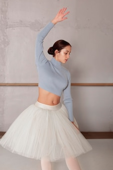 Front view of ballerina in tutu skirt practicing ballet