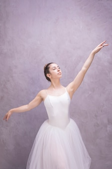 Front view ballerina with stucco background