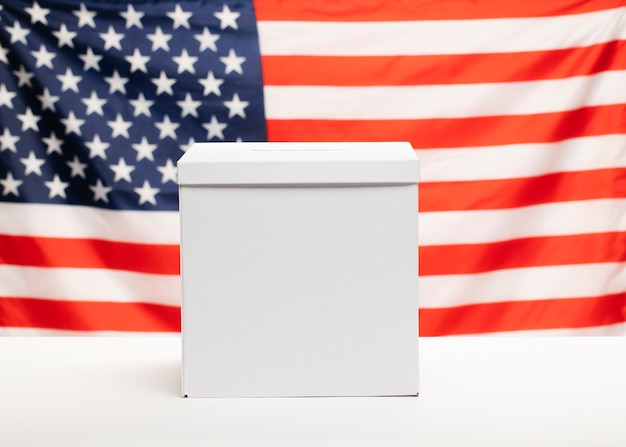 Front view ballot box with american flag on background