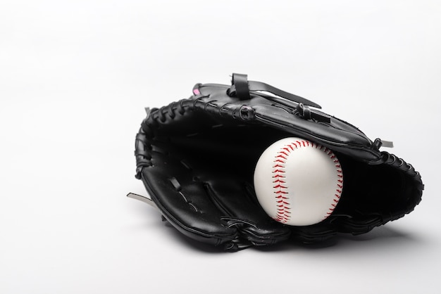 Front view of baseball in glove with copy space