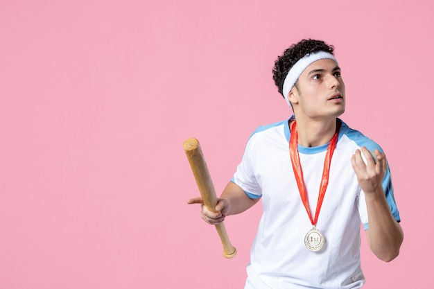 Front view baseball player in sport clothes with medal