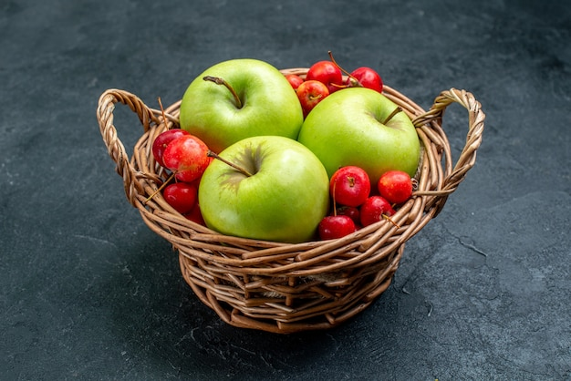 Front view basket with fruits apples and sweet cherries on dark surface fruit berry composition freshness tree
