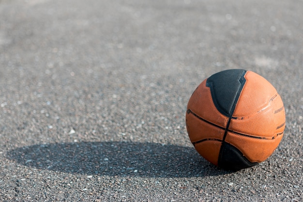 Front view basketball on asphalt