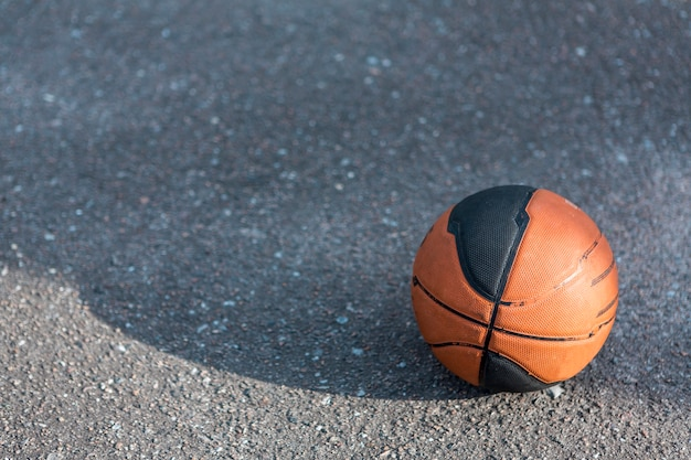 Front view basketball on asphalt