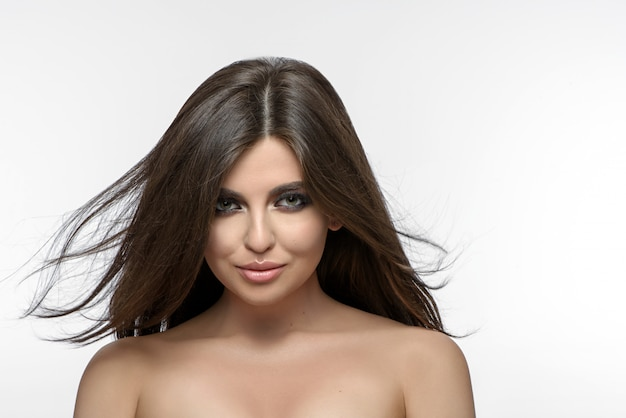Front view of beatiful brunette looking at camera