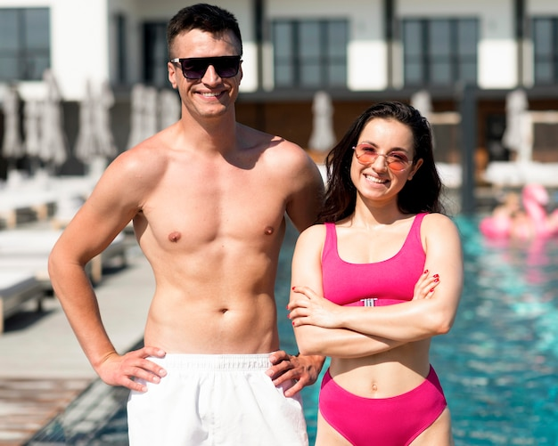 Front view of beautiful couple at pool
