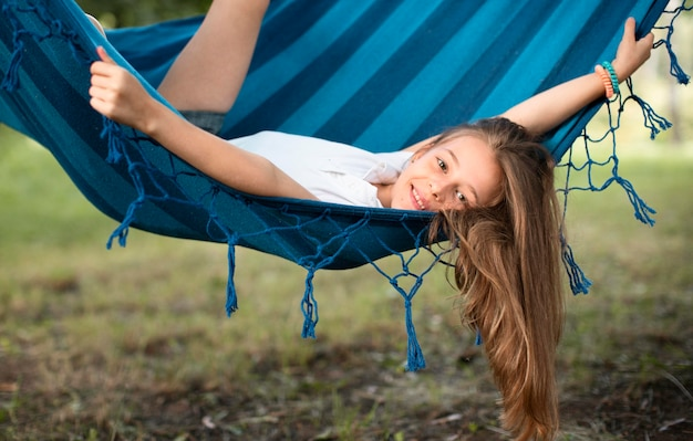 Front view of beautiful girl in hammock