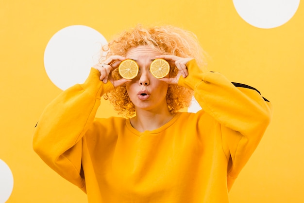 Front view of beautiful girl with lemon slices