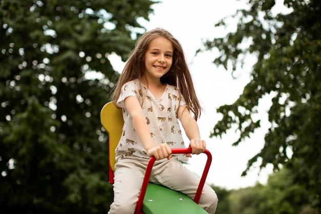 Front view of beautiful happy girl in park