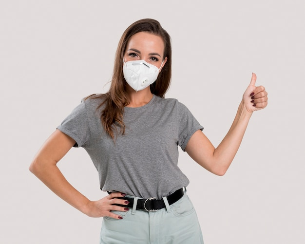 Front view of beautiful woman with face mask