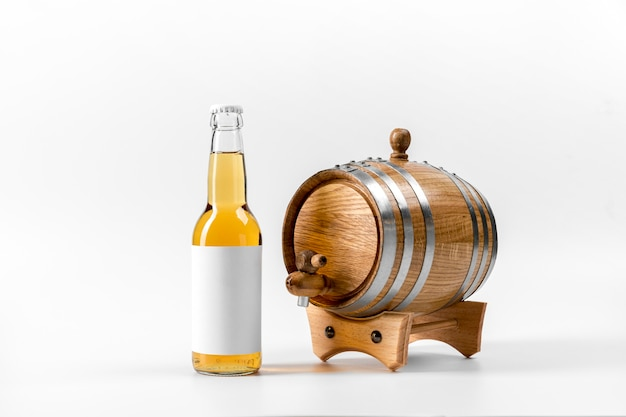 Front view beer bottle with wooden barrel