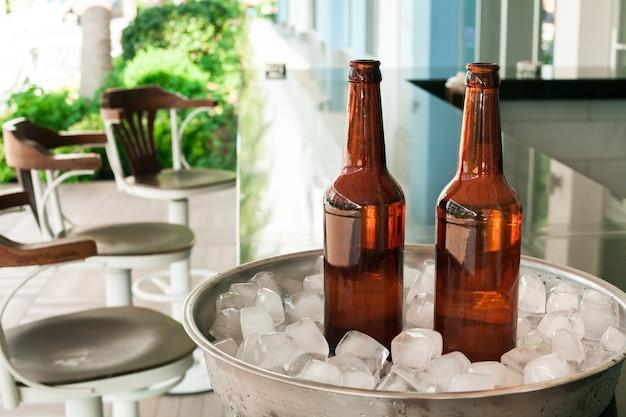 Front view beer bottles at bar