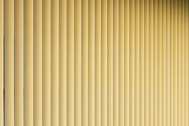 Front view of beige or golden 3d stripes. louvre shutters like pattern with gradient.