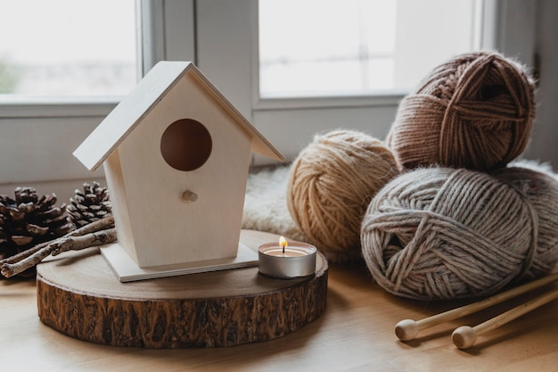 Front view bird house and yarn with candle