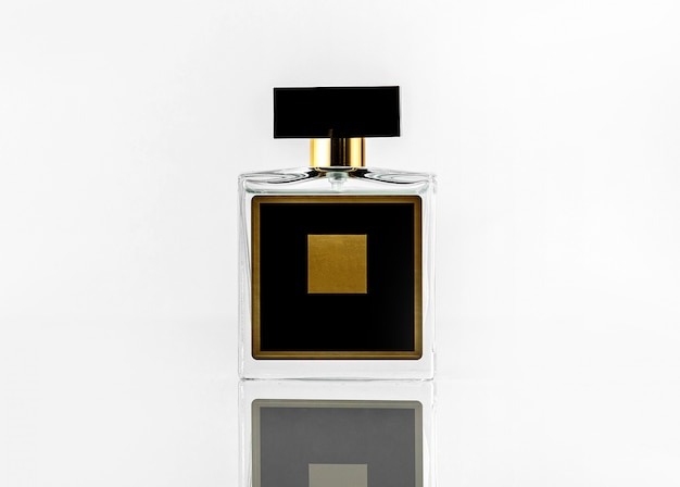 A front view black fragrance bottle with yellow design isolated on the white wall