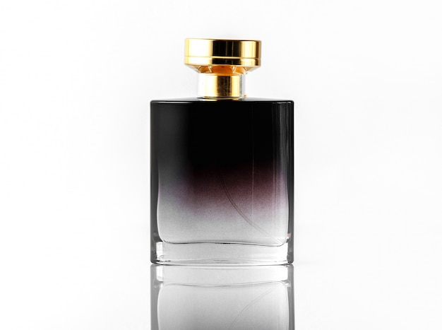A front view black fragrance with golden cap on the white isolated desk