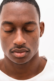Front view of black man crying