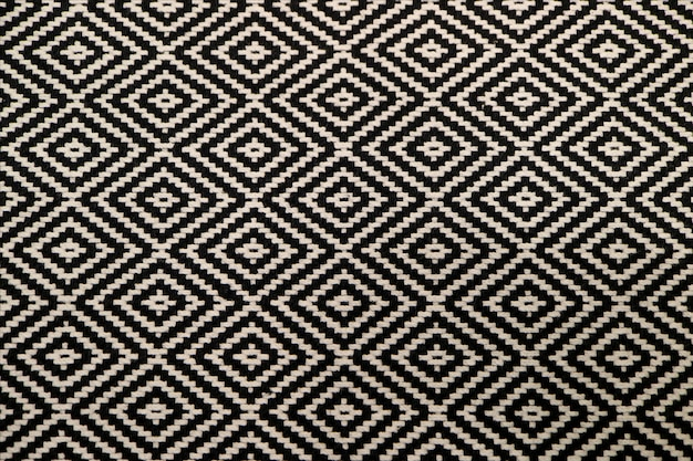 Front view of black and white ethnic pattern fabric for background or banner