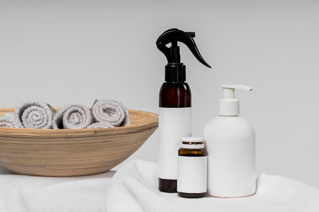 Front view of blank cosmetic product containers in the bathroom
