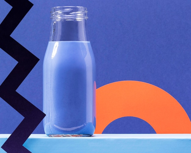 Front view blue smoothie in bottle