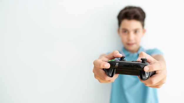 Front view blurred kid holding a controller