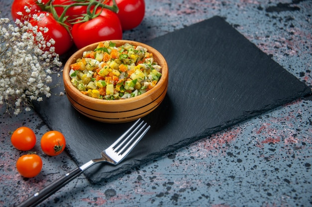 Front view boiled vegetable salad with tomatoes on blue background