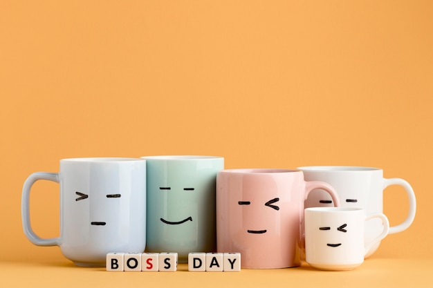 Front view of boss day concept with cups