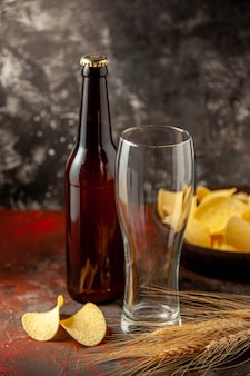 Front view bottle of bear with cips on dark background