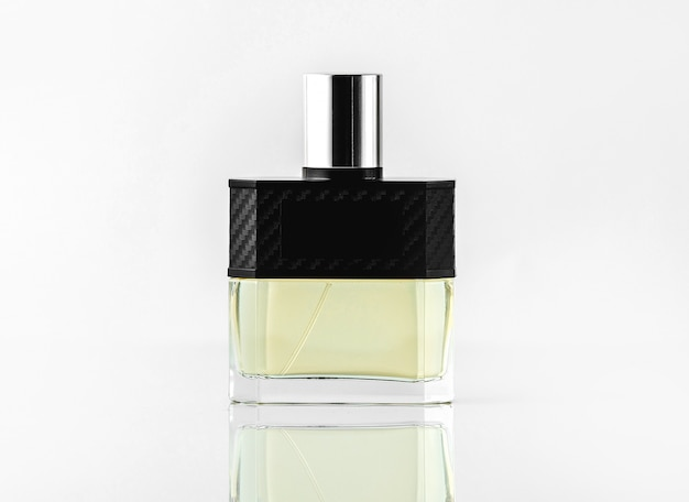 A front view bottle fragrance or parfume in designed colors on the white wall