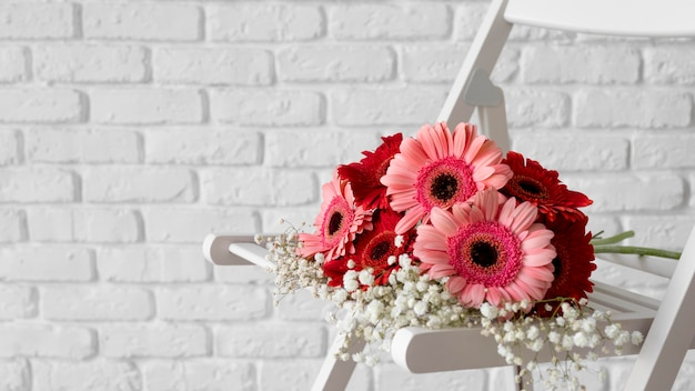Front view of bouquet of flowers on white chair