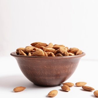 Front view of bowl with almonds and copy space
