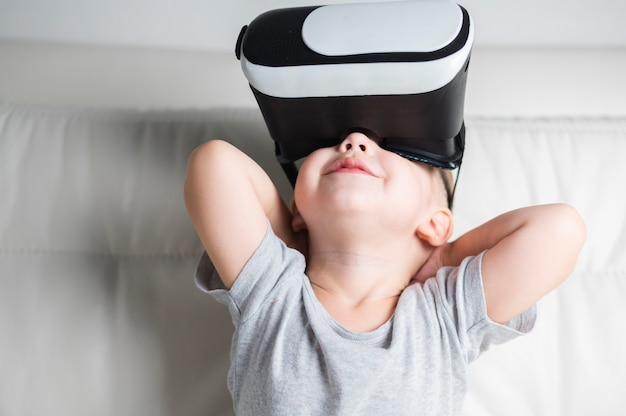 Front view boy enjoying a pair of vr headset