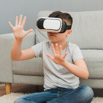 Front view of boy experiencing virtual reality