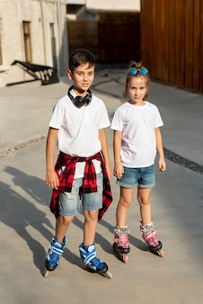 Front view of boy and girl with roller blades